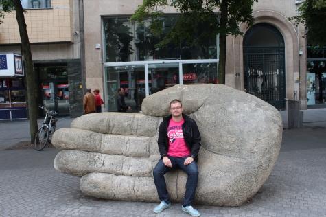 Sitting on Antigoon's Cut Off Hand, in Antwerp's Meir Street