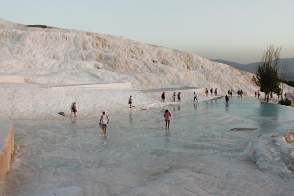 People Walking Through the Pamukkale Hot Springs