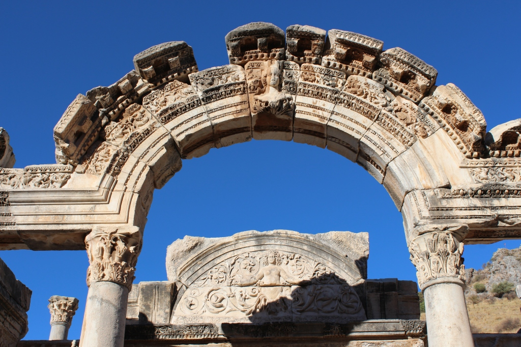 Temple of Hadrian Archway & carving of Medusa on the background (2nd Century AD)