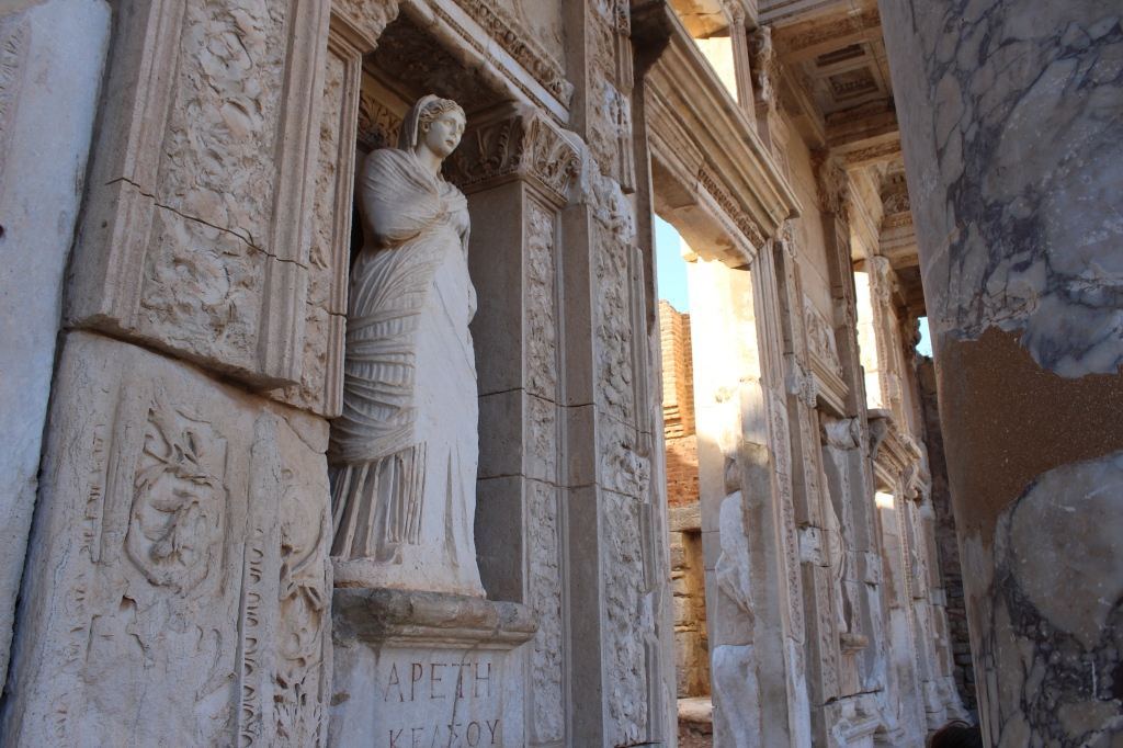 Statue and detailed walls of the Celsus Library